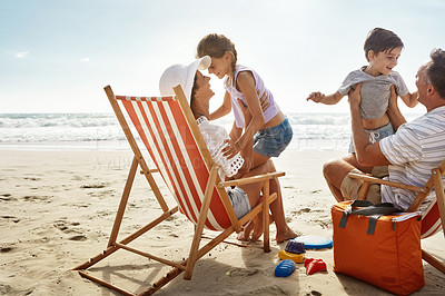 Buy stock photo Shot of a family enjoying some quality time together at the beach