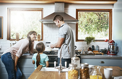 Buy stock photo Shot of a family preparing breakfast together at home