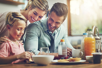Buy stock photo Cropped shot of a little boy eating breakfast with his parents