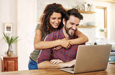 Buy stock photo Cropped shot of a young couple working on a laptop together at home