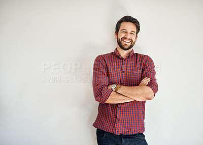 Buy stock photo Portrait of a happy and confident young man standing posing against a gray wall