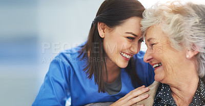 Buy stock photo Shot of a happy senior woman and her young nurse bonding on the couch at home