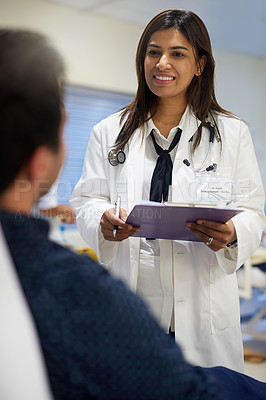 Buy stock photo Shot of a doctor attending to a patient in a hospital