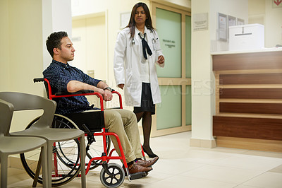 Buy stock photo Shot of a man sitting in a wheelchair in a hospital
