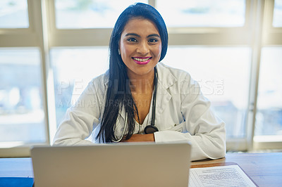 Buy stock photo Portrait of a female doctor working on a laptop in her office