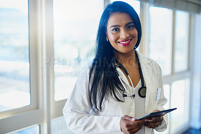 Buy stock photo Portrait of a female doctor using a digital tablet in a hospital