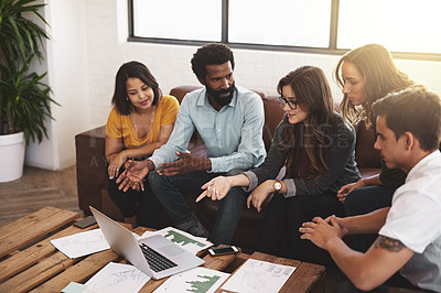 Buy stock photo High angle shot of a group of young designers having a meeting in a modern office