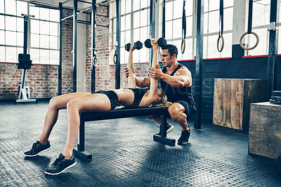 Buy stock photo Shot of a couple working out at the gym