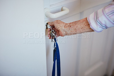 Buy stock photo Cropped shot of an elderly woman putting keys into the door at home