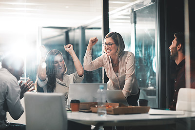 Buy stock photo Shot of colleagues celebrating during a meeting in a modern office