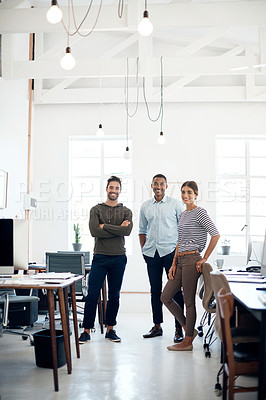 Buy stock photo Portrait of a group of young designers standing together in an open office