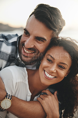 Buy stock photo Shot of a young man hugging his girlfriend from the back while spending the day outdoors