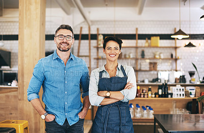 Buy stock photo Portrait of a confident man and woman working together in a coffee shop