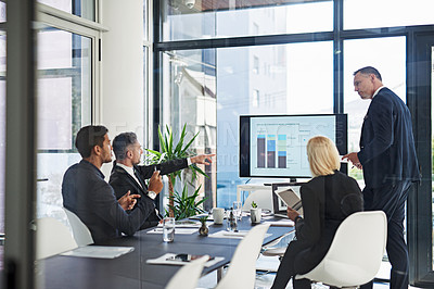 Buy stock photo Shot of corporate businesspeople meeting in the boardroom