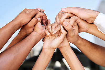 Buy stock photo Cropped shot of a group of unrecognizable people's hands