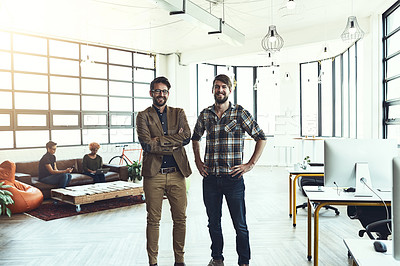 Buy stock photo Shot of two designers standing in a modern office