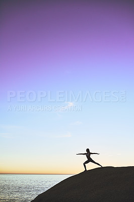 Buy stock photo Shot of an athletic young woman practicing yoga on the beach