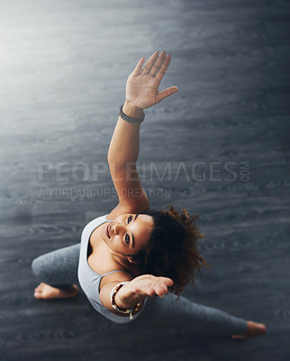 Buy stock photo High angle shot of a young woman practising yoga
