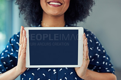 Buy stock photo Cropped shot of a young woman holding up a digital tablet with a blank screen
