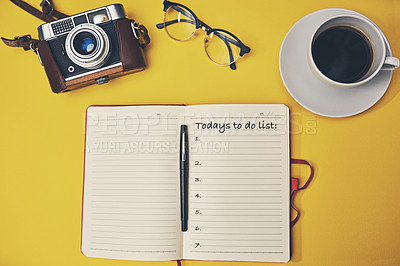Buy stock photo High angle shot of a notebook with a to do list on a yellow desk