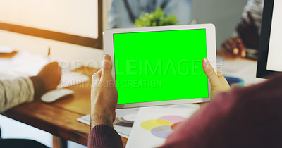 Buy stock photo Shot of an unrecognisable businessperson holding a digital tablet with a chroma key screen