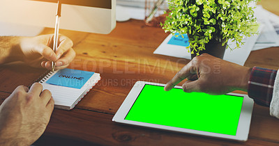 Buy stock photo Shot of an unrecognisable businessperson working on a digital tablet with a chroma key screen