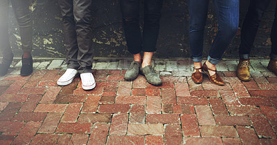 Buy stock photo Cropped shot of a diverse group of people standing together on a paved sidewalk