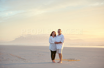 Buy stock photo Shot of mature people enjoying the sunset on the beach