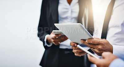 Buy stock photo Cropped shot of unrecognizable businesspeople using their wireless devices in the office