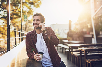 Buy stock photo Cropped shot of a handsome man talking on his cellphone