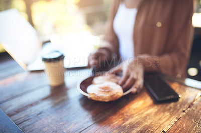 Buy stock photo Cropped shot of a customer sitting in a coffee shop