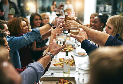 Buy stock photo Cropped shot of a group of young friends toasting during a dinner party at a restaurant