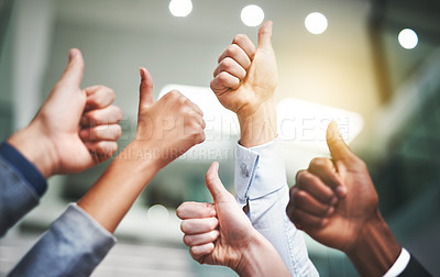 Buy stock photo Closeup shot of a group of unrecognisable businesspeople showing thumbs up in an office