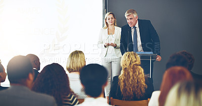 Buy stock photo Cropped shot of two corporate businesspeople reading out the names of recipients during a ceremony