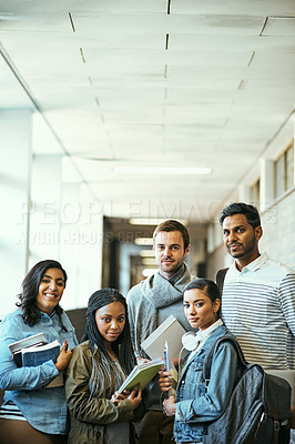 Buy stock photo Cropped portrait of a group of university students standing in a campus corridor