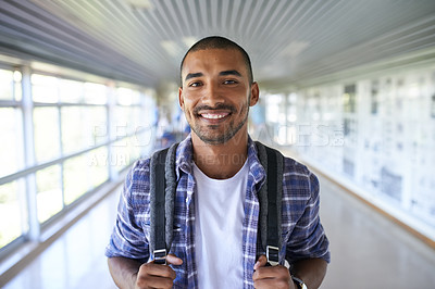 Buy stock photo Portrait of a happy young man standing in a corridor on campus