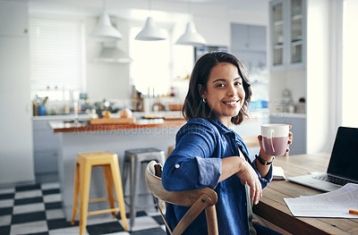 Buy stock photo Shot of a young woman having a coffee break while working from home