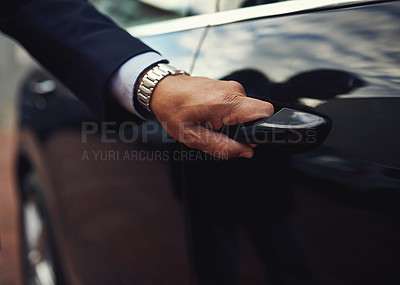 Buy stock photo Cropped shot of a businessman opening a car door