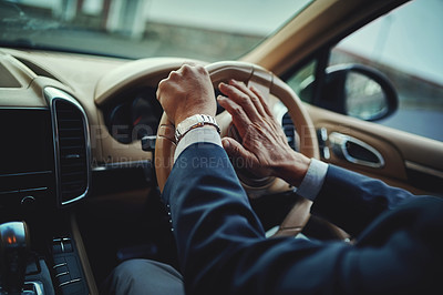 Buy stock photo Cropped shot of a businessman pressing the hooter on a steering wheel
