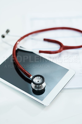 Buy stock photo Cropped shot of a stethoscope and a digital tablet lying on a table
