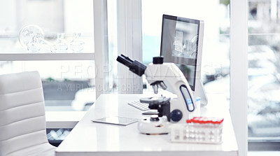 Buy stock photo Shot of a desk with scientific equipment on it inside of a laboratory