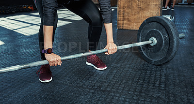 Buy stock photo Shot of an unrecognizable woman lifting weights in a gym