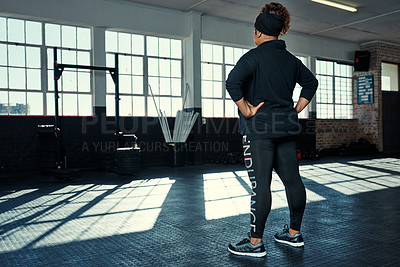 Buy stock photo Rearview shot of an unrecognizable woman in a gym