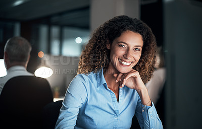 Buy stock photo Cropped portrait of an attractive young businesswoman working late at the office