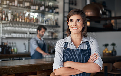 Buy stock photo Cropped shot of an attractive young woman standing with her arms folded in her coffee shop
