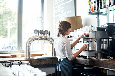 Buy stock photo Cropped shot of an attractive young female barista at work in her coffee shop