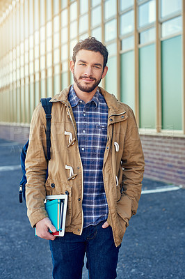 Buy stock photo Shot of a college student between classes on campus grounds