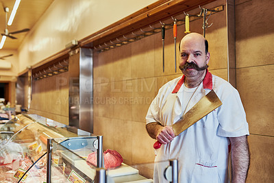 Buy stock photo Shot of a butcher at his store