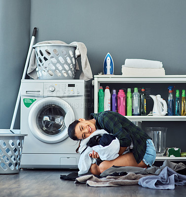 Buy stock photo Full length portrait of an attractive young woman clutching a pile of freshly washed laundry
