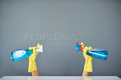 Buy stock photo Studio shot of an unrecognizable woman's holding cleaning products while wearing rubber gloves